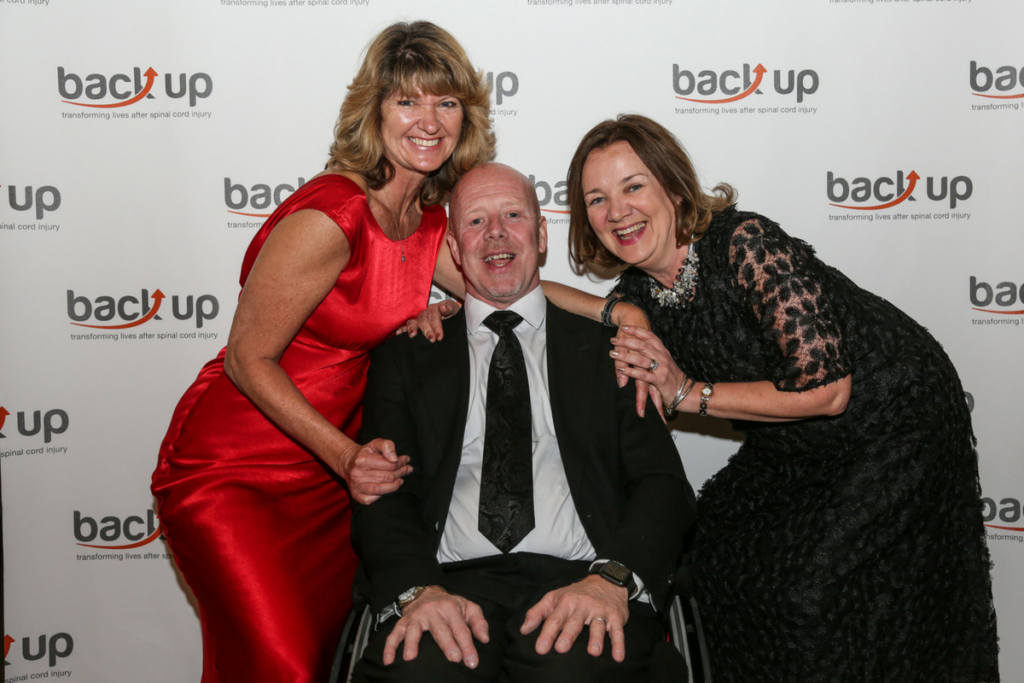 Our beneficial speakers, John and Sue, and our CEO Sarah smile for the camera
