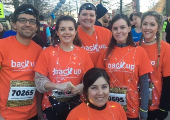 Group of people taking part in a fundraiser for Back Up