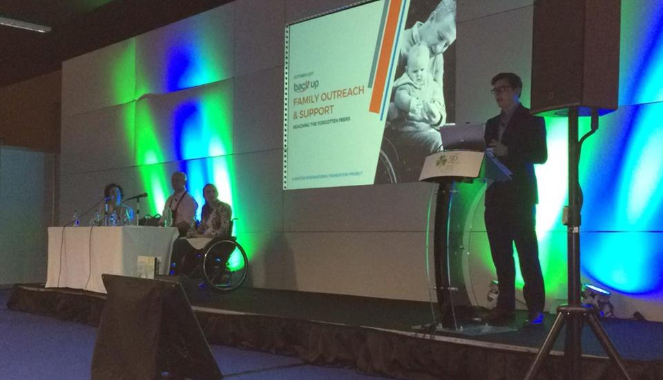 Staff member Andrew speaks at the 56th International Spinal Cord Injury Conference