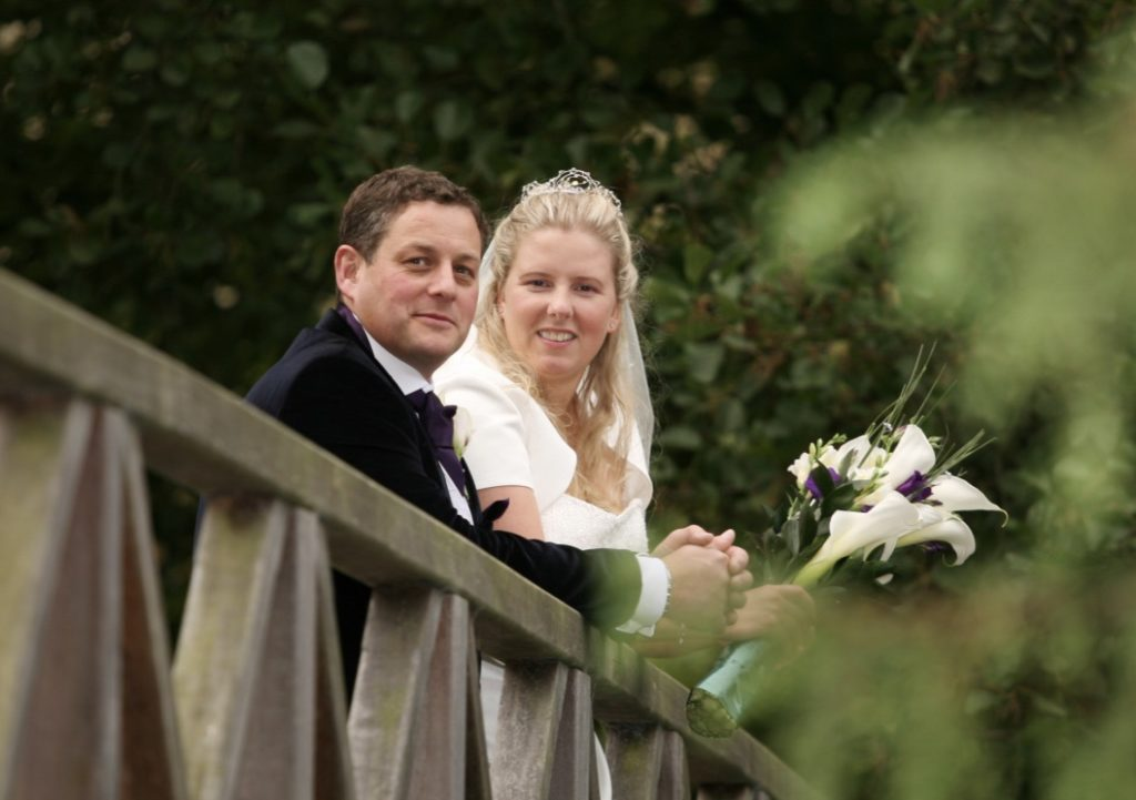 A photo of Tim and his wife on their wedding day displayed in our 'Learning to adjust' story