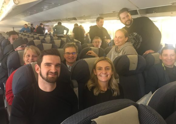 A group of our Colorado sit ski participants on a plane