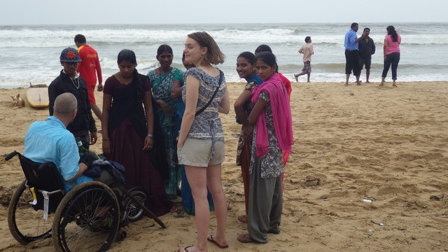 Dave speaking to local people on a beach in Goa