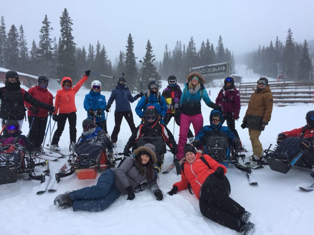 Back Up group posing for a photo out on a snowy slope
