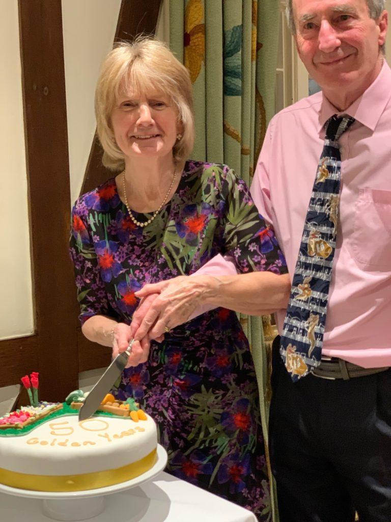 Alan and Sandra cutting their 50th wedding anniversary cake