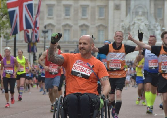 Wheelchair racer fist pumping during London Marathon