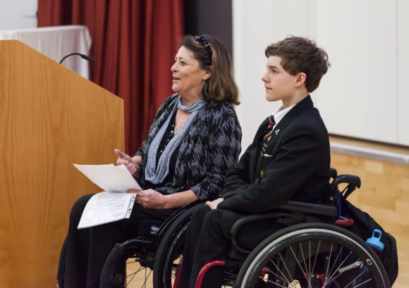 An education advocate and student - both with a spinal cord injury - giving a presentation to the school community