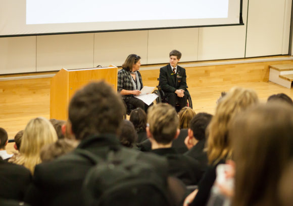 Kevin, one of our young volunteers, giving a talk on spinal cord injury at his school