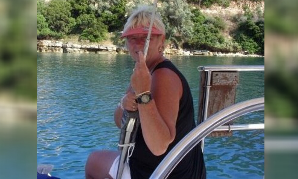 Elaine, who was supported by a back up mentor, on a boat before her injury
