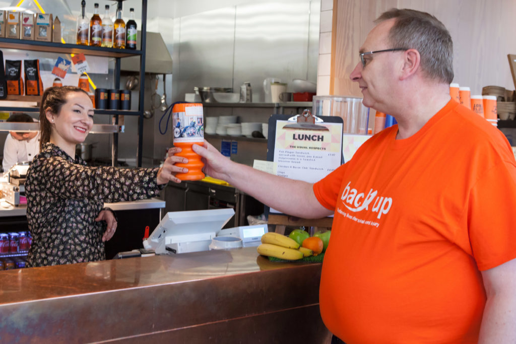 Alan fundraising for Back Up at a local cafe