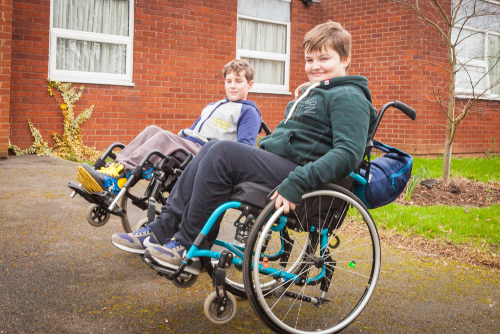 Sam, a young wheelchair user who we supported with education inclusion