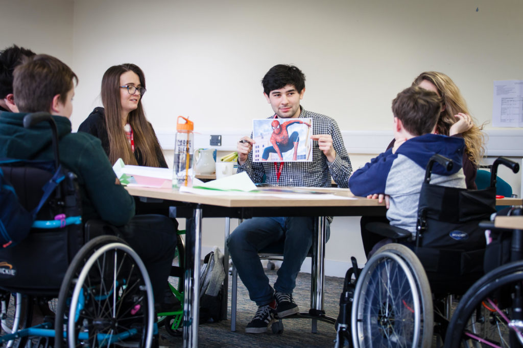 Young wheelchair users and volunteers at a training weekend