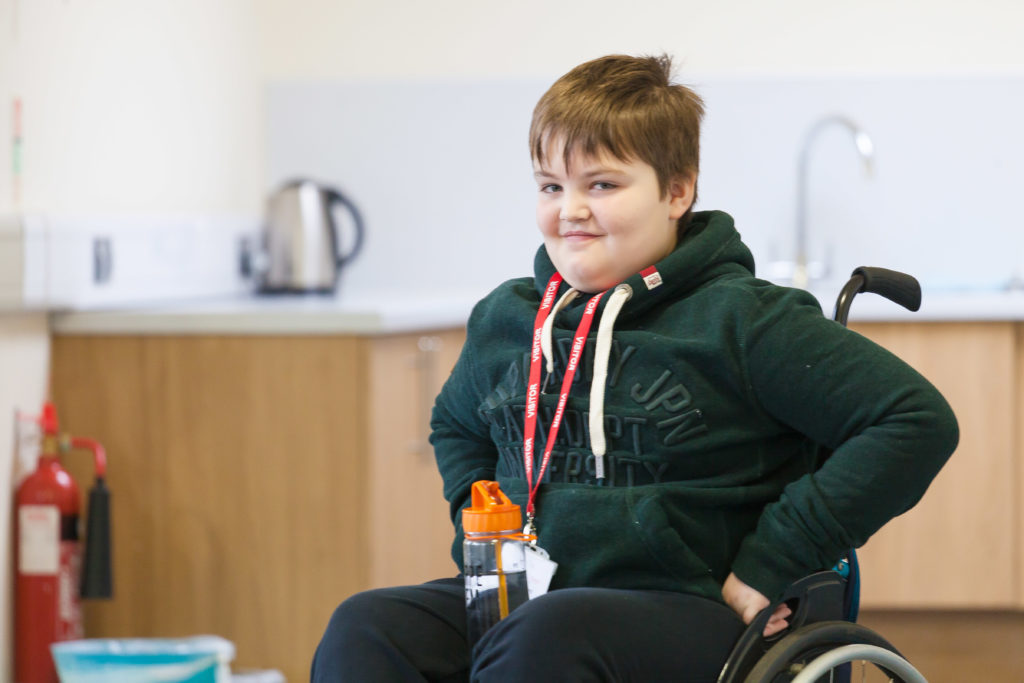 Young wheelchair user on a training weekend