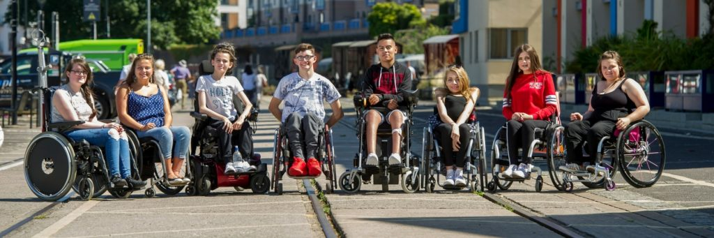 Group of young wheelchair users on our city skills course