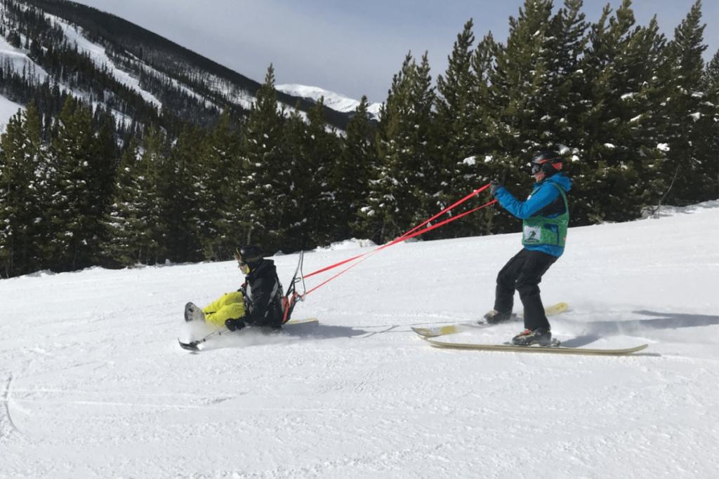 Ian sit skiing, enjoying some travel after spinal cord injuryy