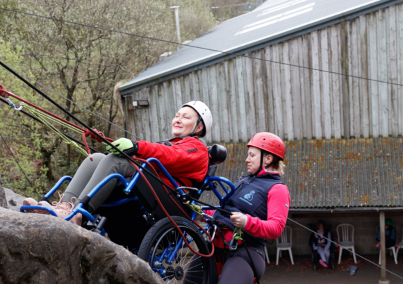 A participant abseiling on one of our Back Up courses