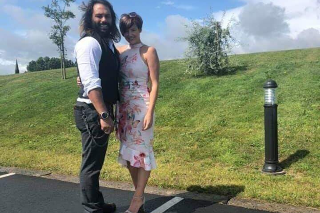 Adrian posing with his wife Louise in a car park
