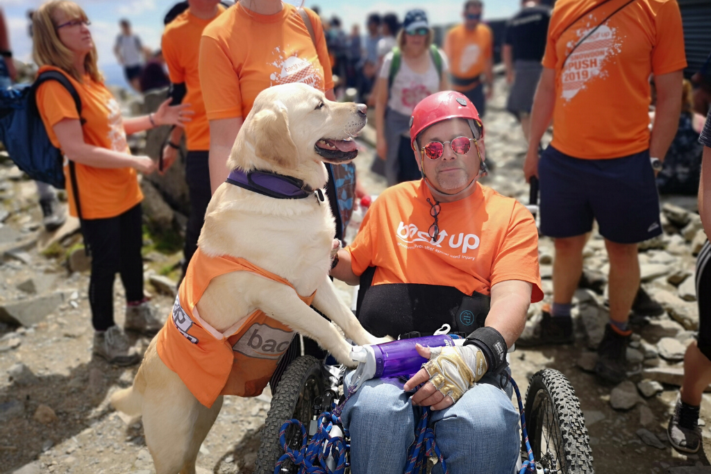 Tim with his dog Elliot on top of Mount snowdon while taking on the Snowdon Push challenge