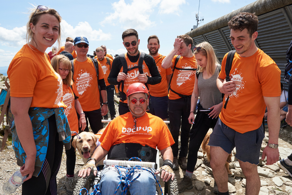 Tim and his family at the summit of mount snowdon after completing our Snowdon Push challenge