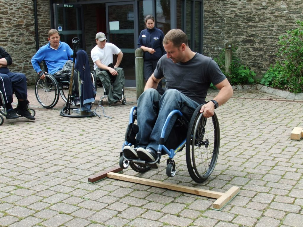 A volunteer wheelchair user leading a skills session on a course