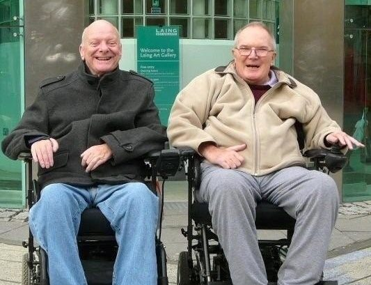 two happy elderly gent wheelchair users