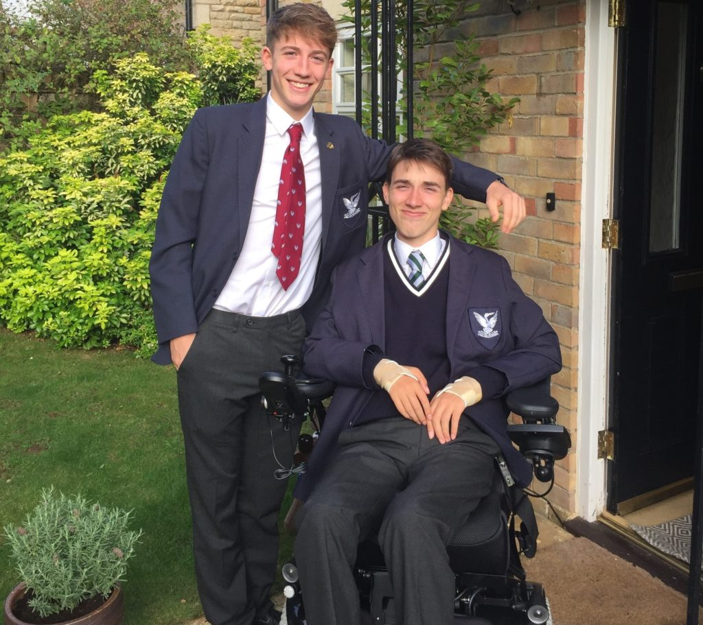 George posing with his brother wearing his school uniform, ready to get back into school
