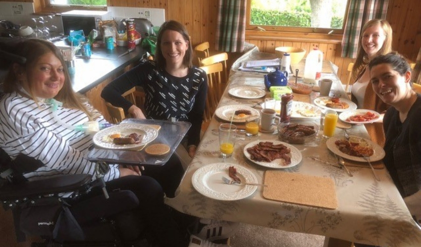 Hannah enjoying breakfast with her friends