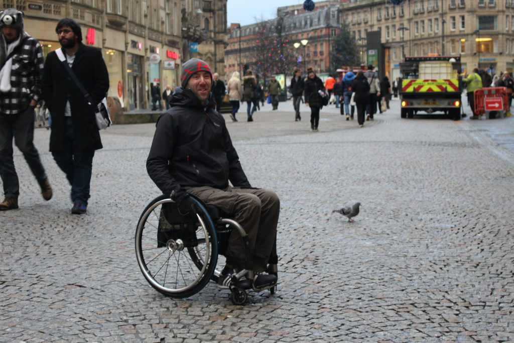 Wheelchair user in a busy City