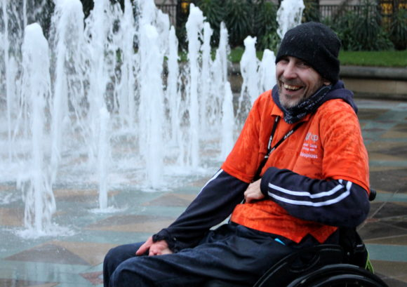 A wheelchair skills trainer outside a fountain