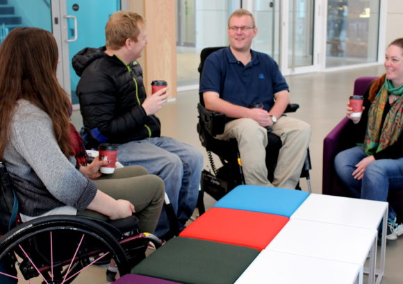 group of people with a spinal cord injury chat about taking care of their emotional wellbeing
