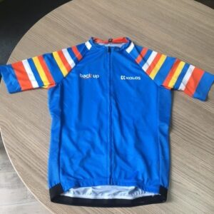 Front of a blue #NoLimits cycling jersey with stripes on the sleeves