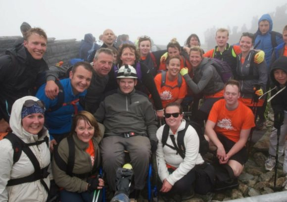 Joe at the top of Mount Snowdon with his Snowdon Push team