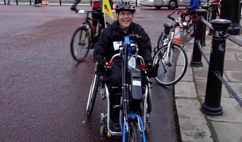 John handcycling to maintain his independence over time