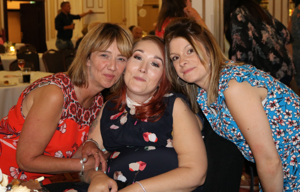Supporter Lauren in between two friends at her 30th birthday party