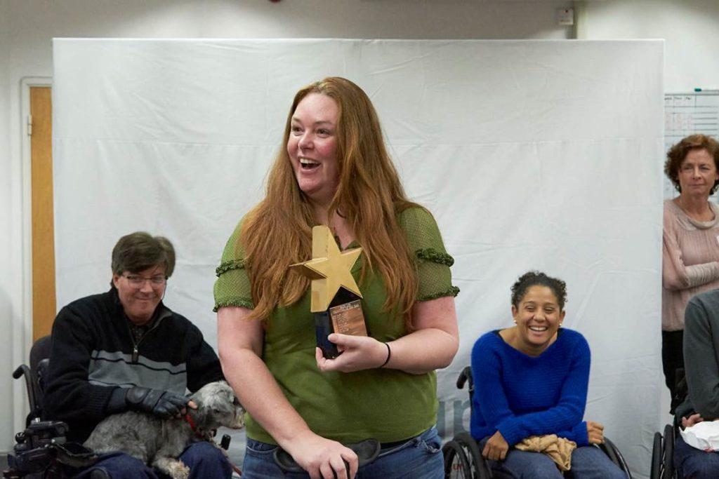 Kim, a Back Up volunteer, receives her Volunteer of the Year award