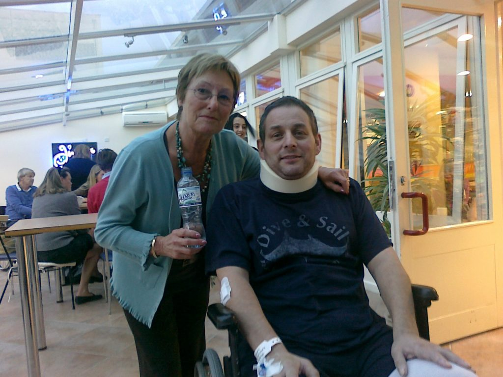 Photo of Tim with his mum at hospital for his 'Learning to adjust' story