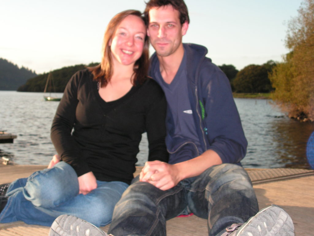 Anna is sat with her now husband Pete by the side of a lake