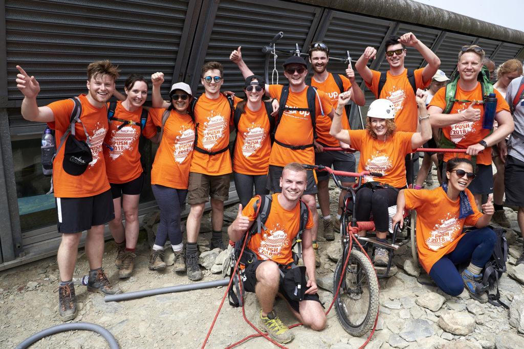 "The ""ACG Cliffhangers"" team posing on Mount Snowdon during the Snowdon Push"