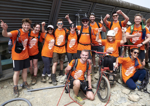 "The ""ACG Cliffhangers"" team posing on Mount Snowdon during the Snowdon Push"