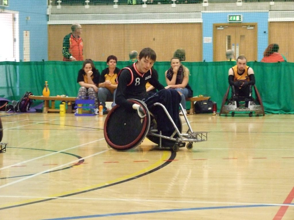 Sam playing wheelchair rugby