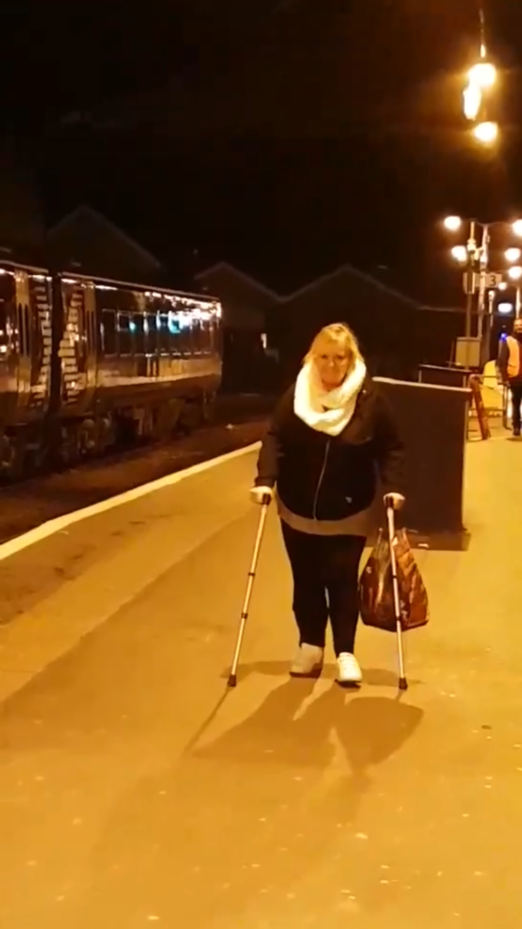 Fiona walking with aids after being discharged from the spinal centre