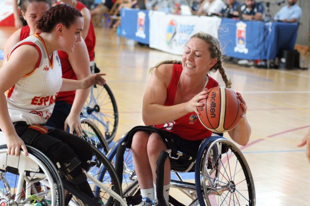 photo of Sophie playing wheelchair basketball