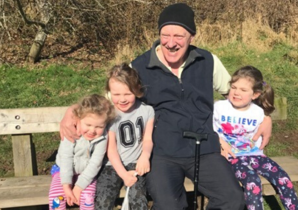 tom, a man who regained his independence after spinal cord injury,, sitting with his family