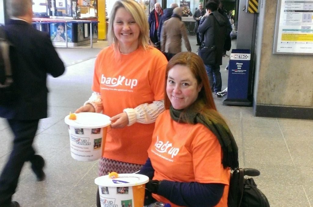 Michelle, this months Back up Star, posing at a bucket collection