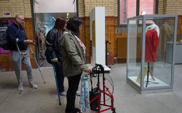 A group of spinal cord injured participants exploring the People's History Museum