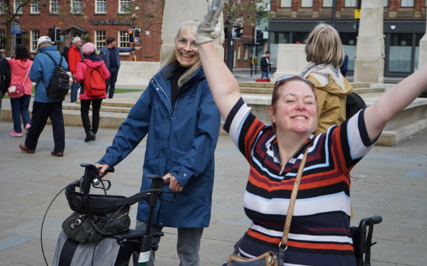Two of our participants, one a wheelchair user and one walking with the aid of a frame, exploring the centre of manchester