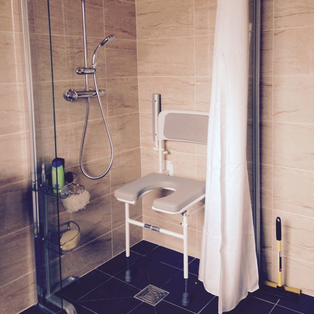 A photo of Roger's bathroom, adapted with a shower seat so he can shower independently.