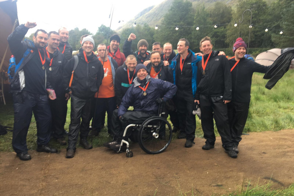 Andrew and his team celebrating after conquering the Ben Nevis push