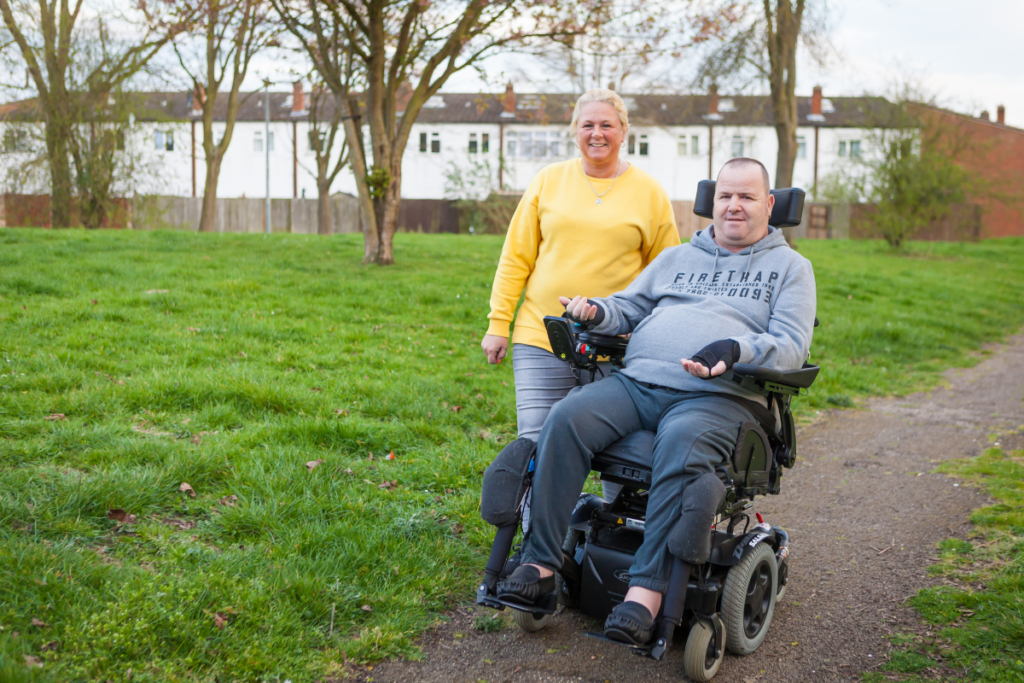 A power chair user out and about - read this article to learn how to prevent pressure ulcer