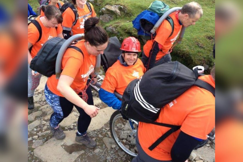 Sean taking on our snowdon push challenge after we helped him with family mentoring after spinal cord injury