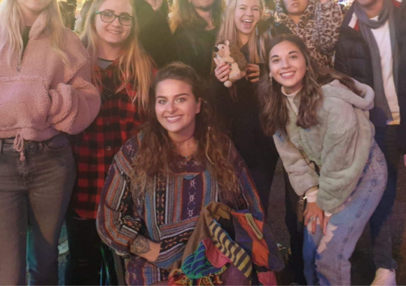 Maisie surrounded by friends at university